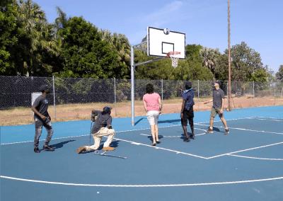 Patrick, Junior, Jake, Tyrell & Oscar playing basketball.
